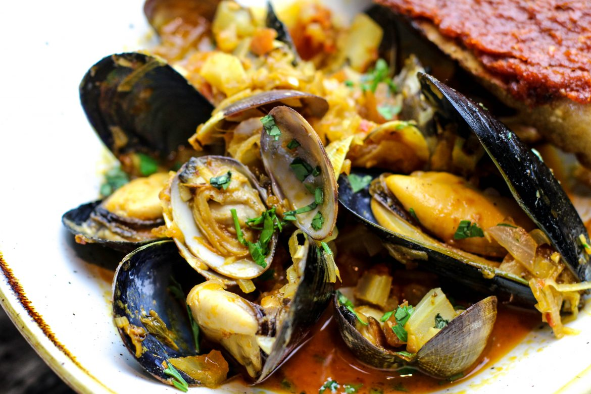 Harissa Clams and Mussels with smoked tomato, leek, fennel, sweet vermouth, 'nduja toast